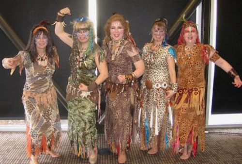Five dancers in animal print costumes