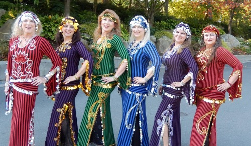 six dancers in striped costumes