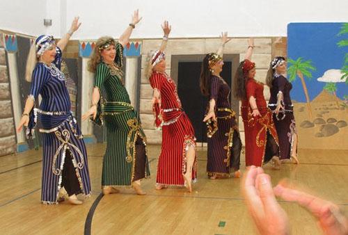 Six dancers at Mediterranean Fantasy Festival in West Seattle.